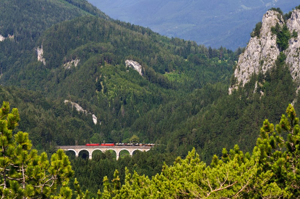 A train passes across a viaduct in the Styrian mountains on the way to Slovenia – Shutterstock