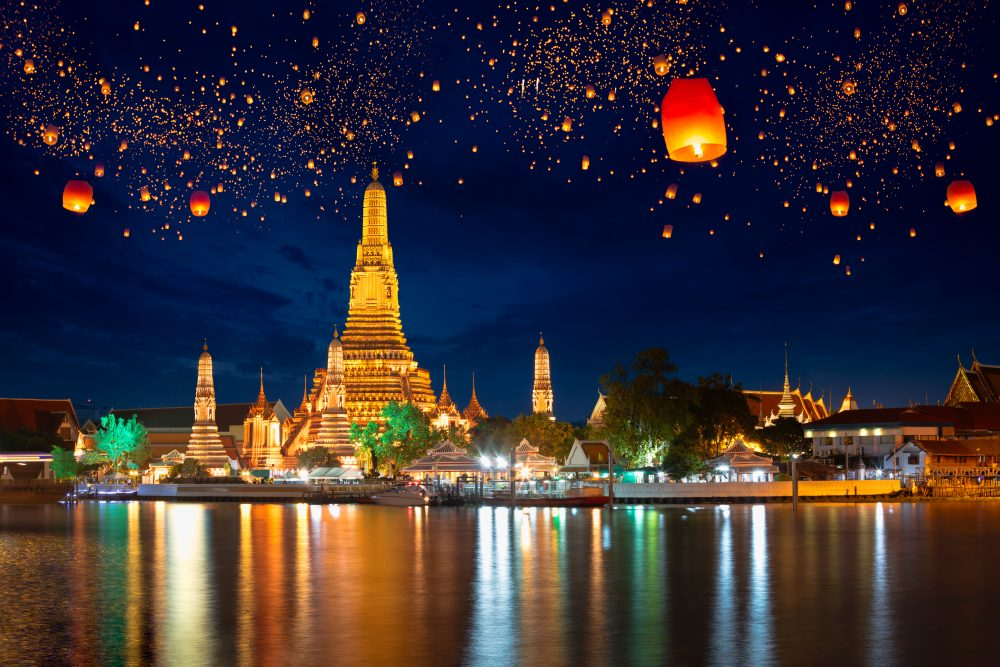 Lanterns float over Wat Arun Temple in Bangkok – Shutterstock