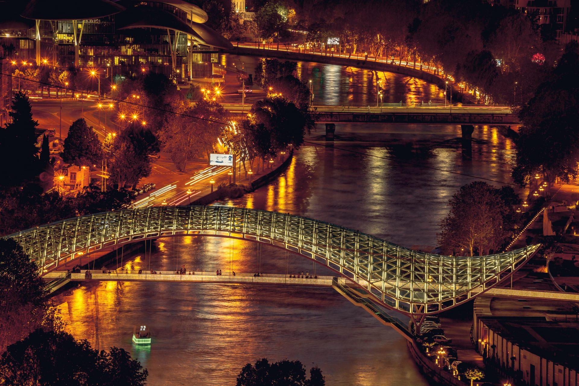 Bridges over the Kura light up at night in Tbilisi – Shutterstock